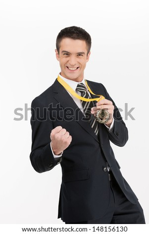 Businessmen with medal. Happy young businessman showing his gold medal while isolated on white - stock photo