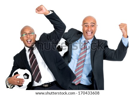 Businessmen with soccer ball isolated in white