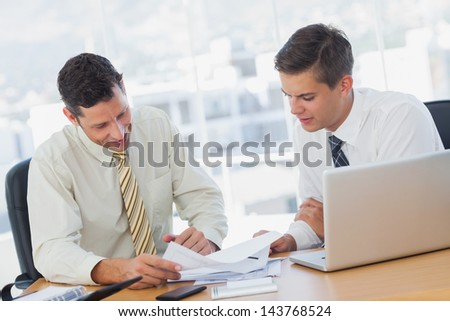 Businessmen working together in the office