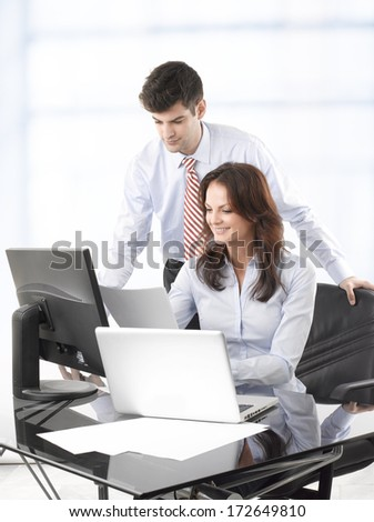 Businessmen working together with his colleague in office - stock photo