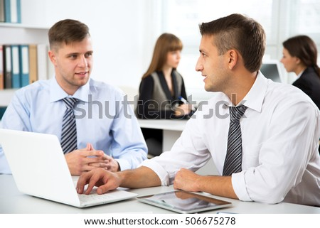 Businessmen working with laptop in an office