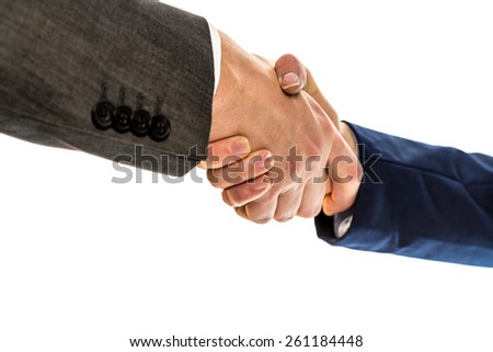Businesspeople, a man and woman in jackets, shaking hands to conclude a business arrangement, in partnership, greeting or congratulations, close up view of their hands over white. - stock photo