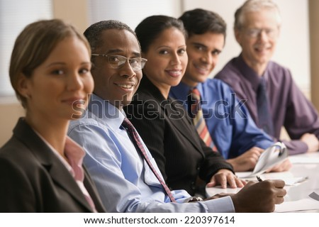 Businesspeople at a meeting - stock photo