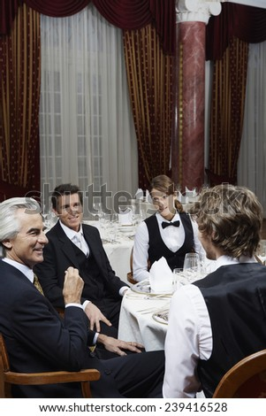 Businesspeople at Dinner - stock photo