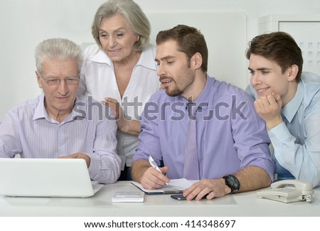businesspeople at office with laptop