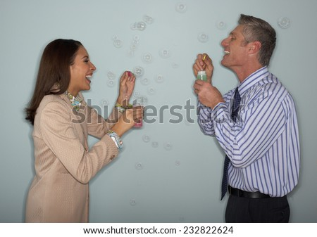 Businesspeople Blowing Bubbles - stock photo