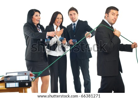 Businesspeople colleagues drink coffee , laugh out loud  and point to a man worker who pulling his desk with folders,concept of one person working hard and others are  looking without doing nothing - stock photo