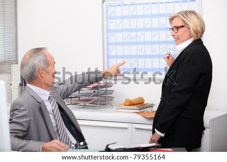 Businesspeople completing schedule