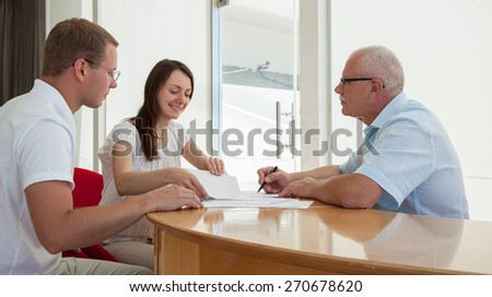 Businesspeople  discussing a joint project during teamwork - stock photo