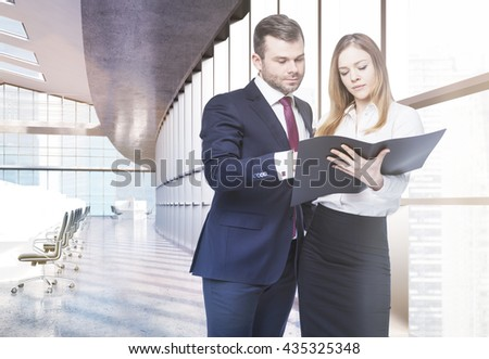 Businesspeople discussing business report in coworking office interior. Concept of teamwork. 3D Rendering - stock photo