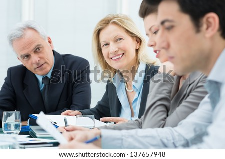 Businesspeople Discussing In Conference Room - stock photo