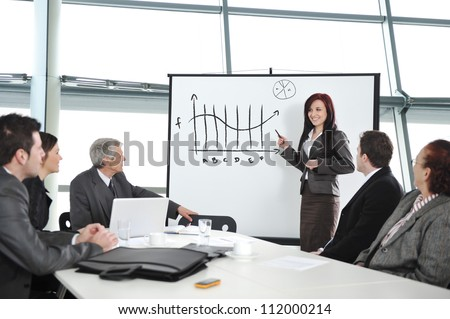 Businesspeople discussing the presentation - stock photo