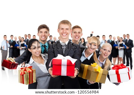 Businesspeople group holding present gift box, young business people standing together happy smile with large team on background
