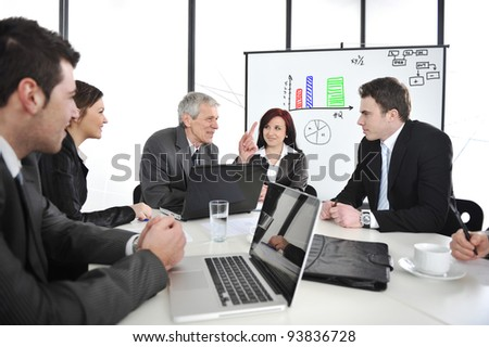 Businesspeople having a business meeting - stock photo