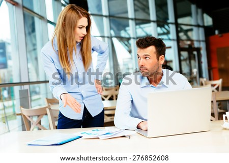 Businesspeople having an argument in an office - stock photo