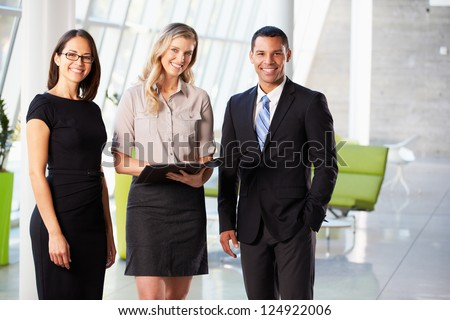 Businesspeople Having Informal Meeting In Modern Office