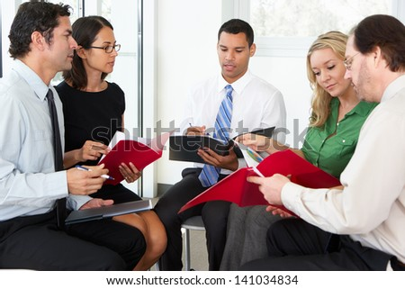Businesspeople Having Informal Office Meeting - stock photo