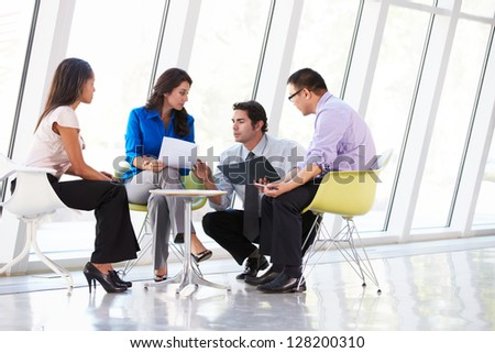 Businesspeople Having Meeting In Modern Office - stock photo