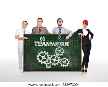 businesspeople holding blackboard with teamwork concept - stock photo