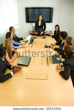 businesspeople in a business meeting in an office smiling - stock photo