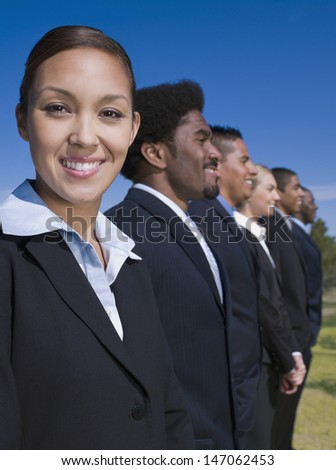 Businesspeople in a row outdoors