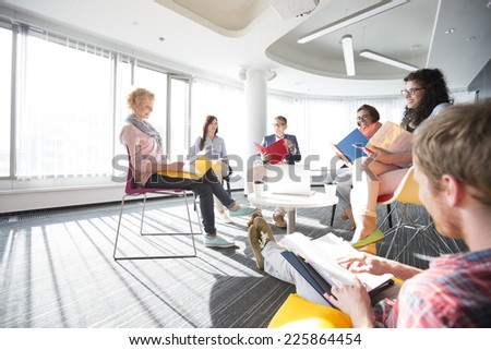 Businesspeople in meeting at office - stock photo