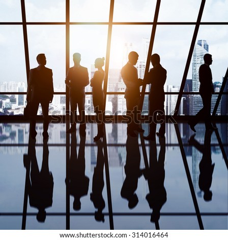 businesspeople in office against background of city - stock photo