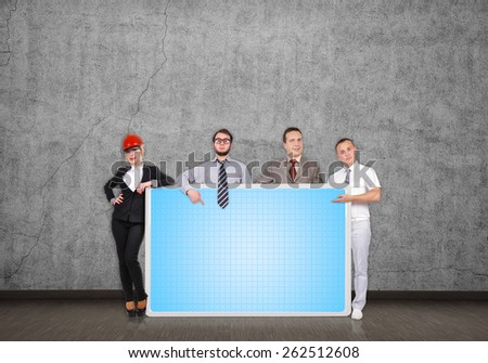 businesspeople in room holding blank plasma panel - stock photo