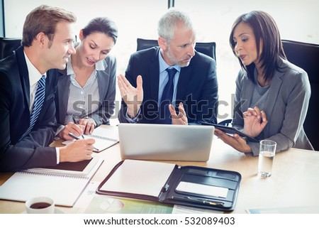Businesspeople interacting at a meeting in conference room at office