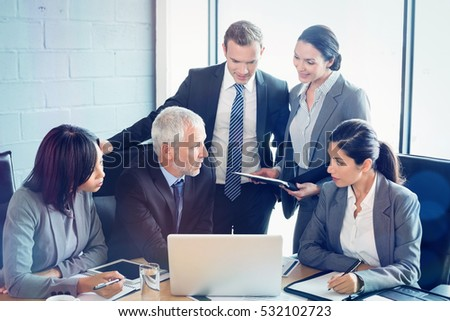Businesspeople interacting at a meeting in room at office