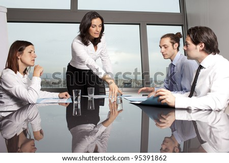 businesspeople interacting at business meeting - stock photo