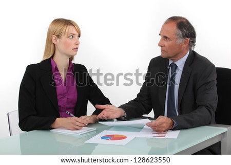 Businesspeople looking at financial results - stock photo
