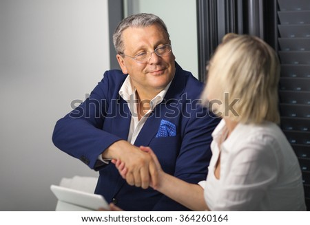 Businesspeople making an agreement with handshake - stock photo