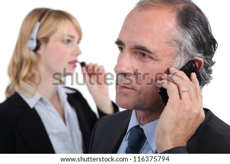 Businesspeople making phone calls