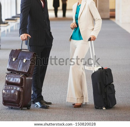 businesspeople meeting at airport