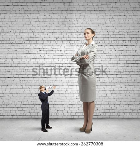 Businesspeople of various sizes. Business relations concept - stock photo