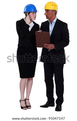 businesspeople on a construction site - stock photo