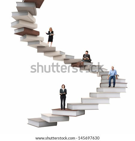 businesspeople on 3d abstract books stair - stock photo