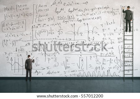 Businesspeople on ladder writing mathermatical formulas on concrete wall. Education concept