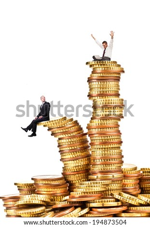 businesspeople on piles of coin - stock photo