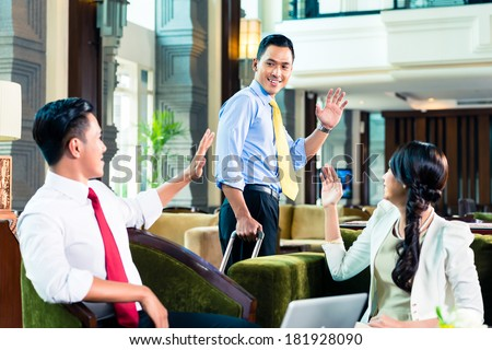 Businesspeople saying goodbye in a hotel - stock photo