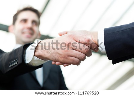 Businesspeople shaking hands at the office - stock photo