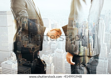 Businesspeople shaking hands on cityscape background. Double exposure - stock photo
