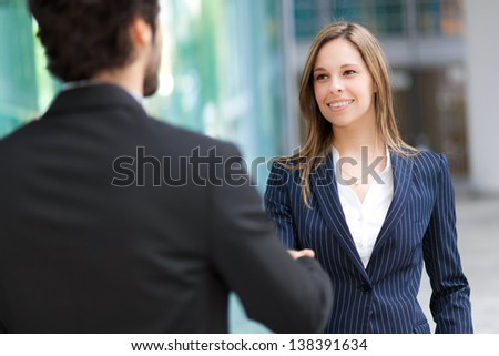 Businesspeople shaking hands outdoor - stock photo