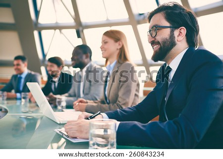 Businesspeople sitting at seminar