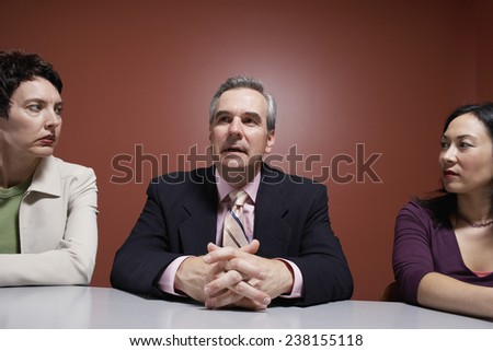 Businesspeople Sitting at Table - stock photo