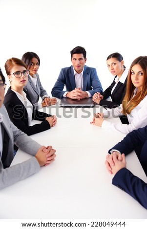 Businesspeople sitting at the table in office on the meeting