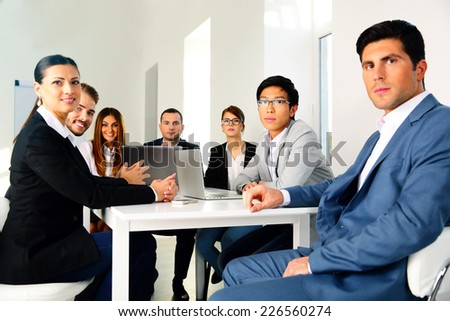 Businesspeople sitting at the table on a meeting - stock photo