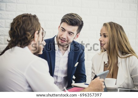 Businesspeople Sitting in office and Work Together. Businessman have a Meeting with Team. Businesspeople Working concept. vintage tone.