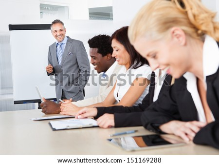 Businesspeople Sitting In Office At The Presentation - stock photo